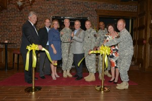 Maj. Gen. Jeff Smith, commander of U.S. Cadet Command and Ft. Knox, cuts the ceremonial ribbon with Joe Bollinger, director of military and transportation for Brown-Forman, to commenorate the grand opening of the Woodford Reserve Room at the Saber and Quill Club on May 15 at Ft. Knox.