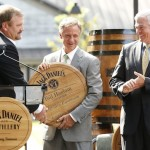 Jeff Arnett hands Jack Dnaiel's barrel head to Gov. Haslam